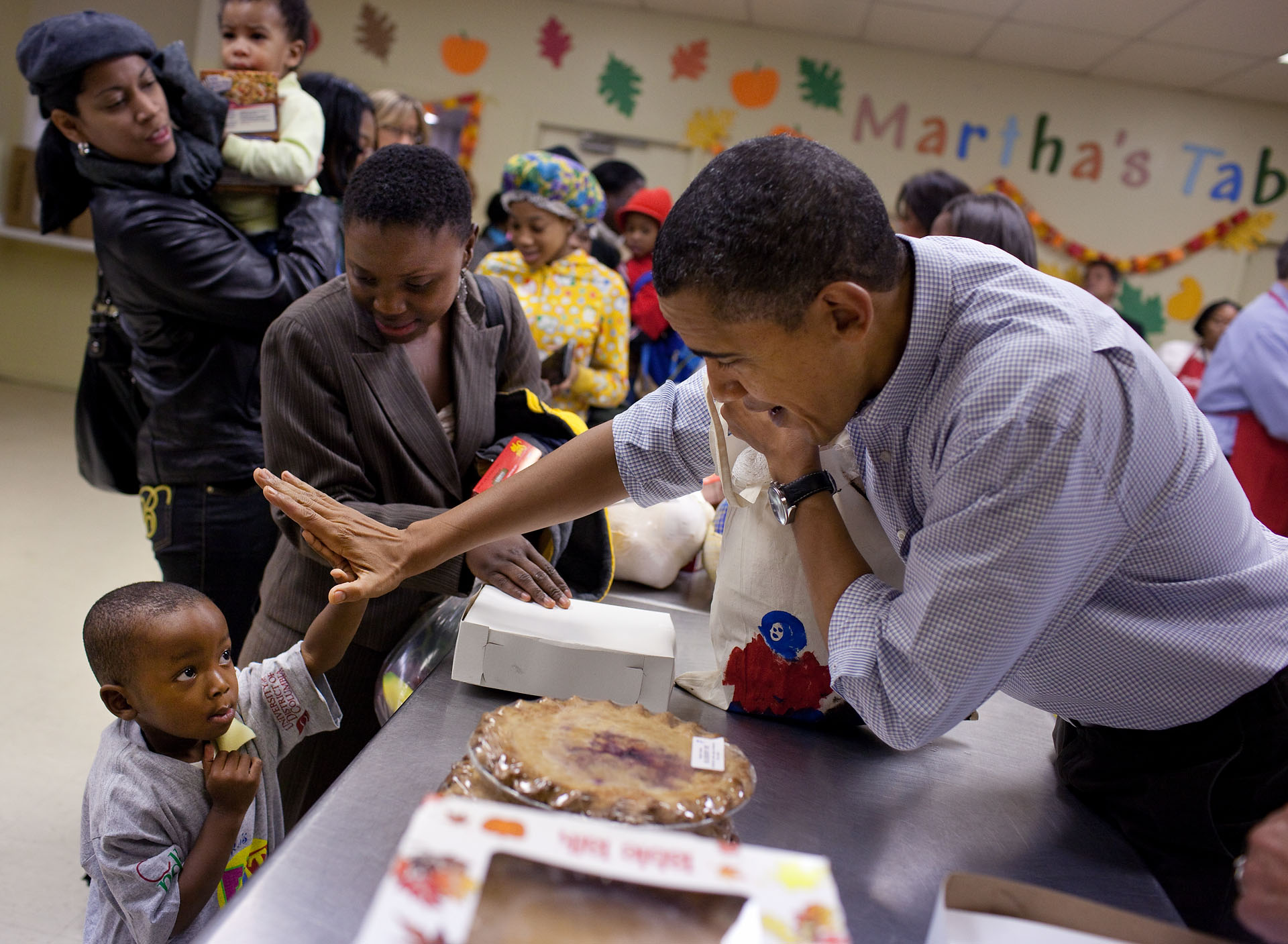 President Barack Obama gets a high five at Martha's Table
