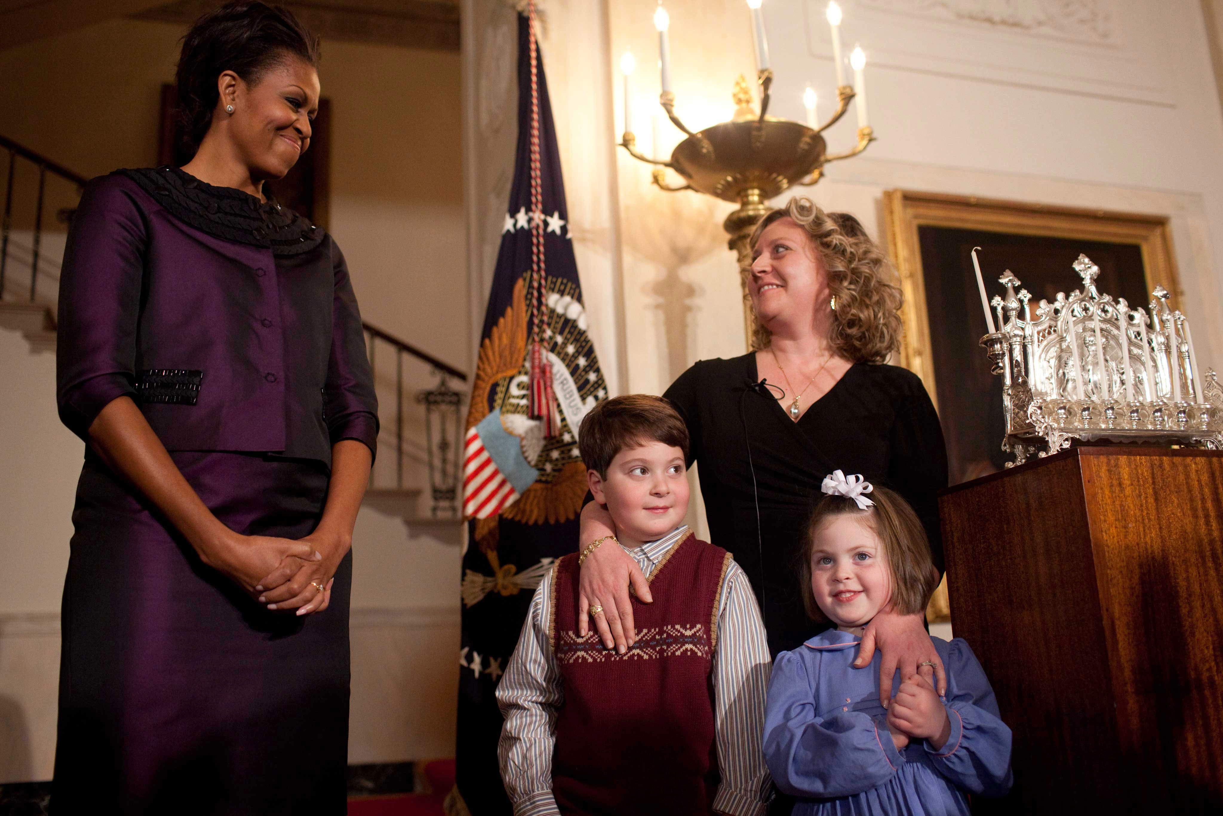 First Lady Michelle Obama stands with Alison Buckholtz and her children at Hanukkah Reception