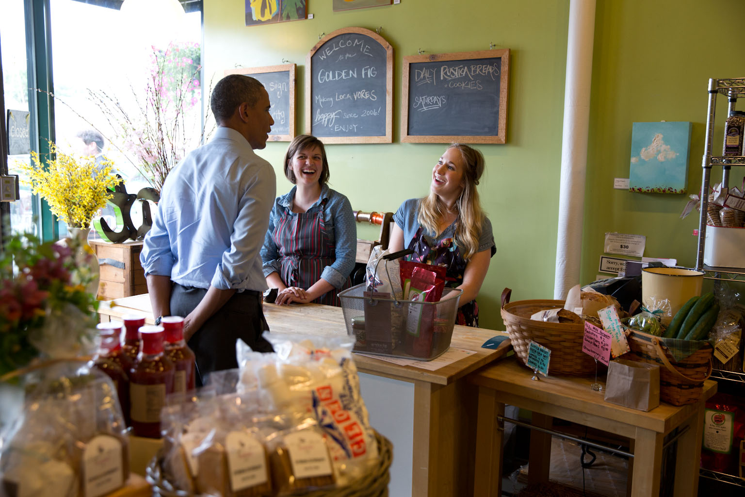 President Barack Obama talks with staff during a stop at the Golden Fig in St. Paul, Minn., June 26, 2014.