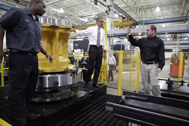 President Barack Obama tours the Linamar Corporation auto-parts plant