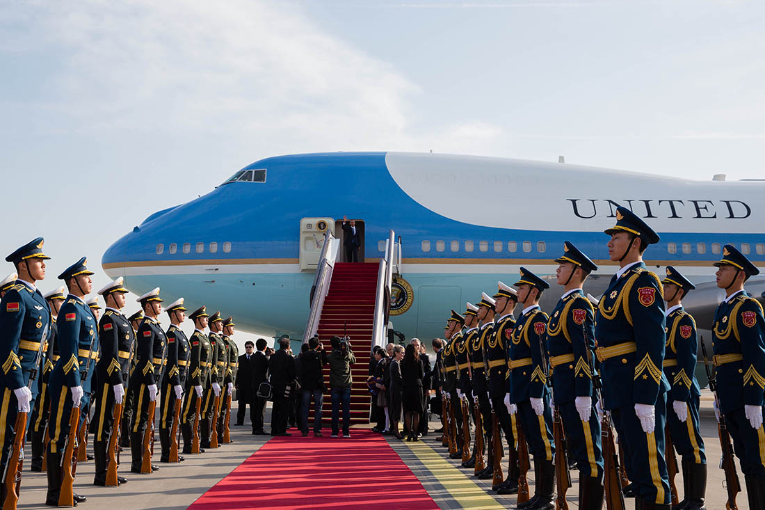 President Barack Obama steps off Air Force One to a red carpet welcome on arrival at Capital International Airport in Beijing