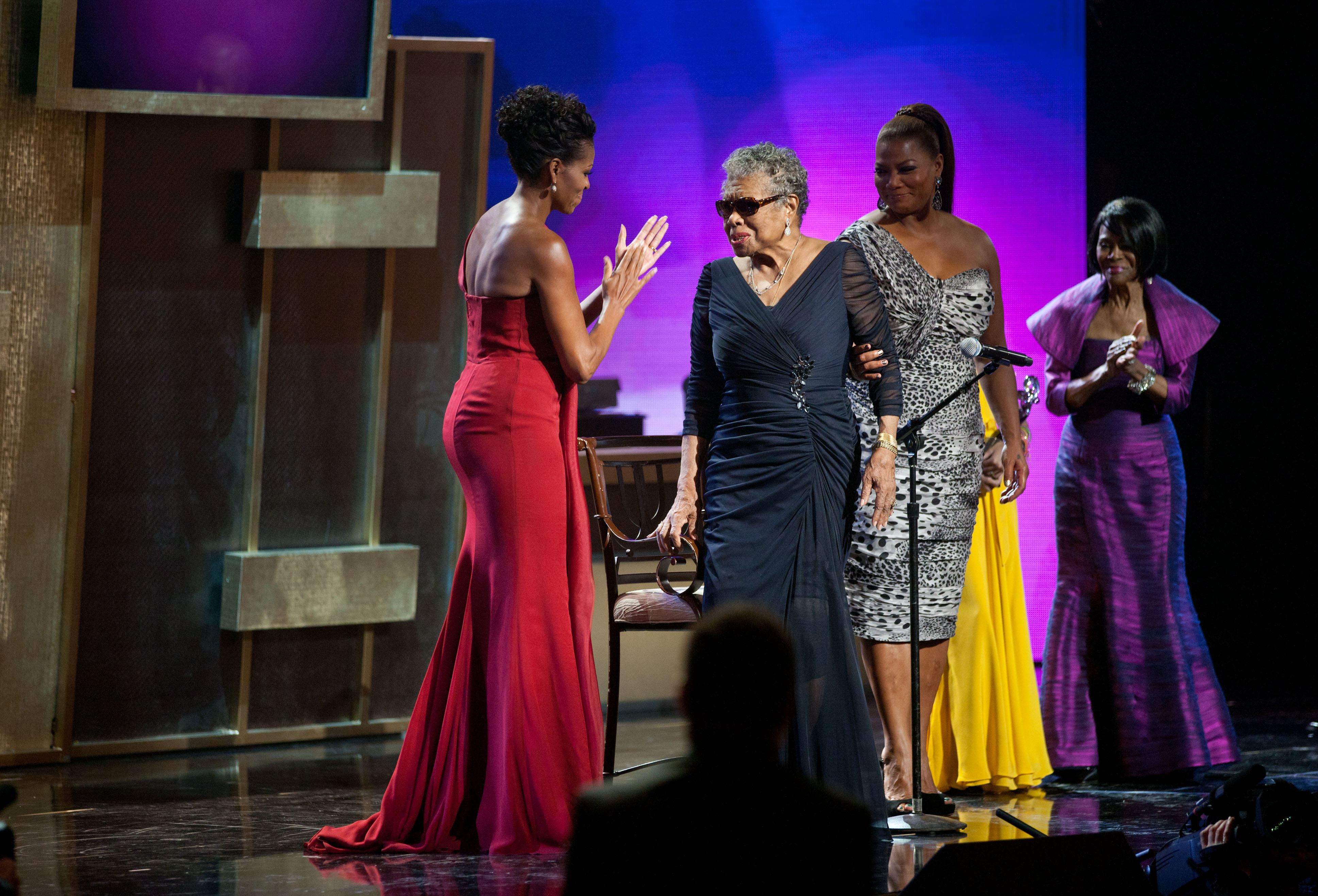 First Lady Michelle Obama applauds Maya Angelo during the BET Awards ceremony