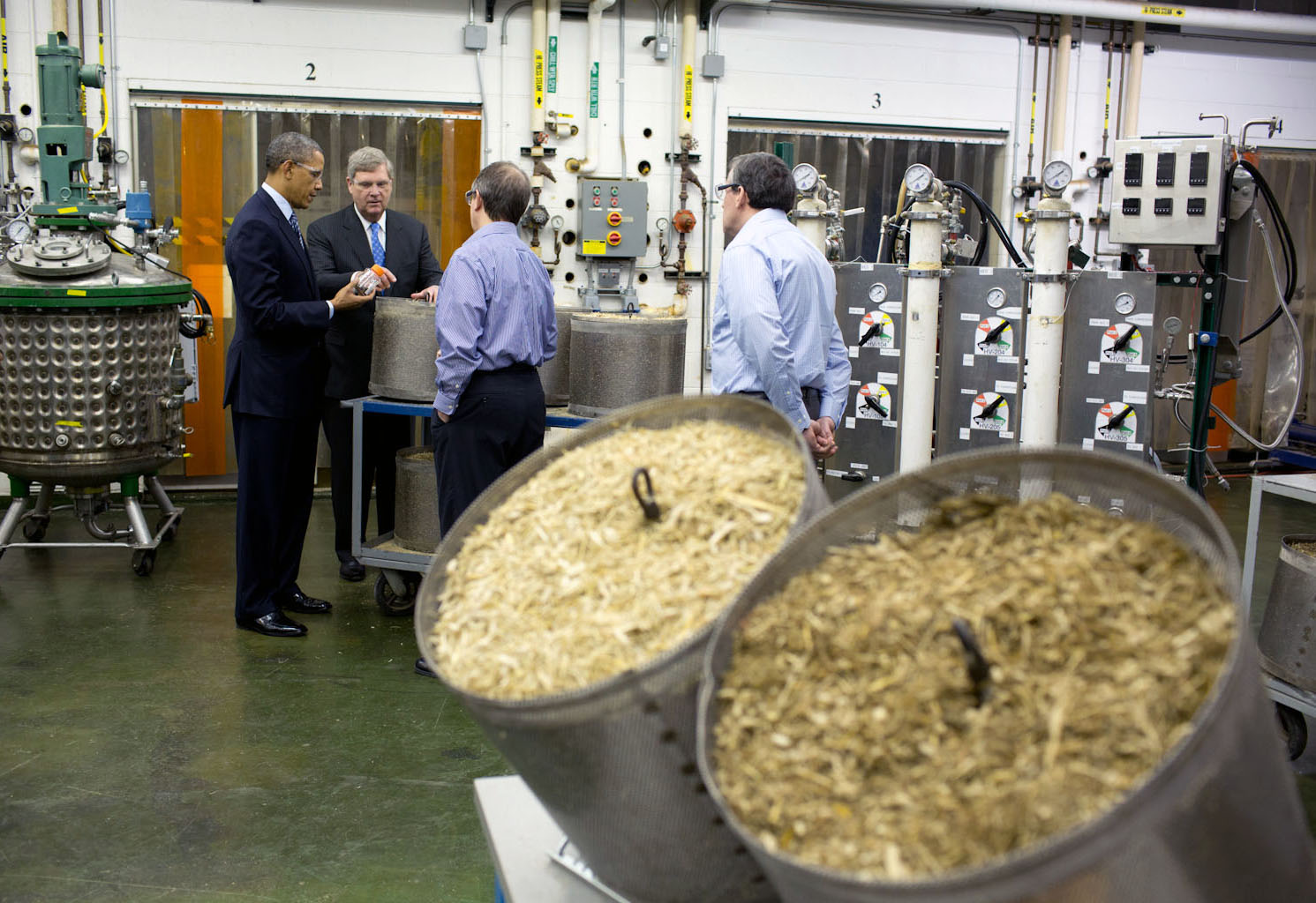 President Barack Obama tours Michigan Biotechnology Institute with Agriculture Secretary Tom Vilsack in Lansing, Mich