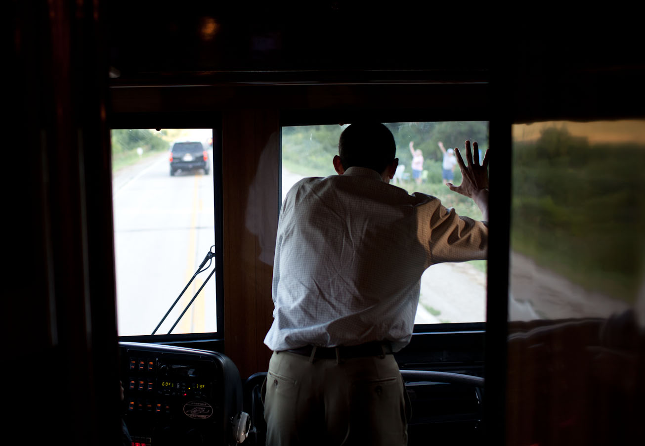 President Obama Waves To People Along The Road In Decorah, Iowa