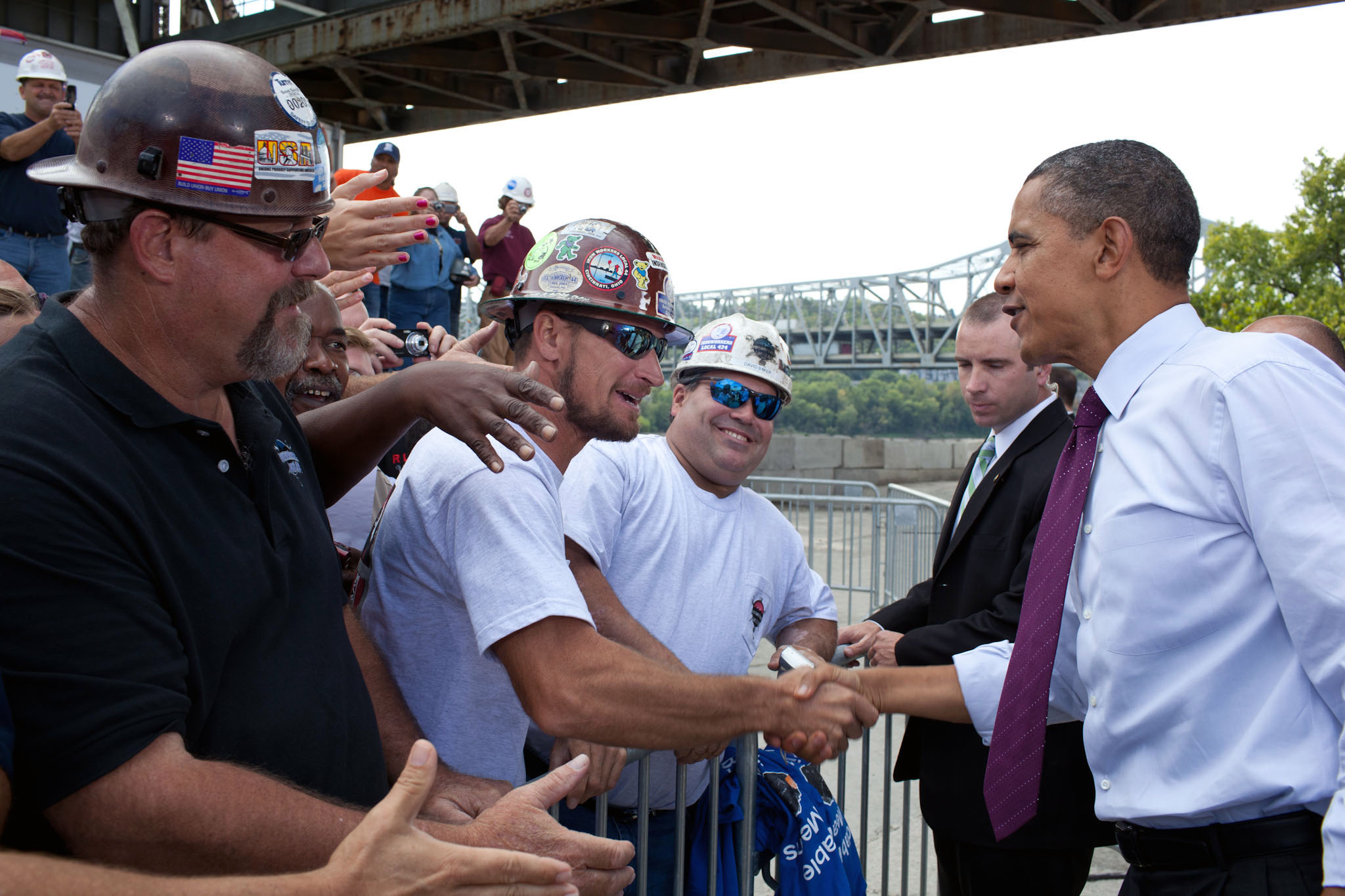 President Barack Obama shakes hands with Construction Workers
