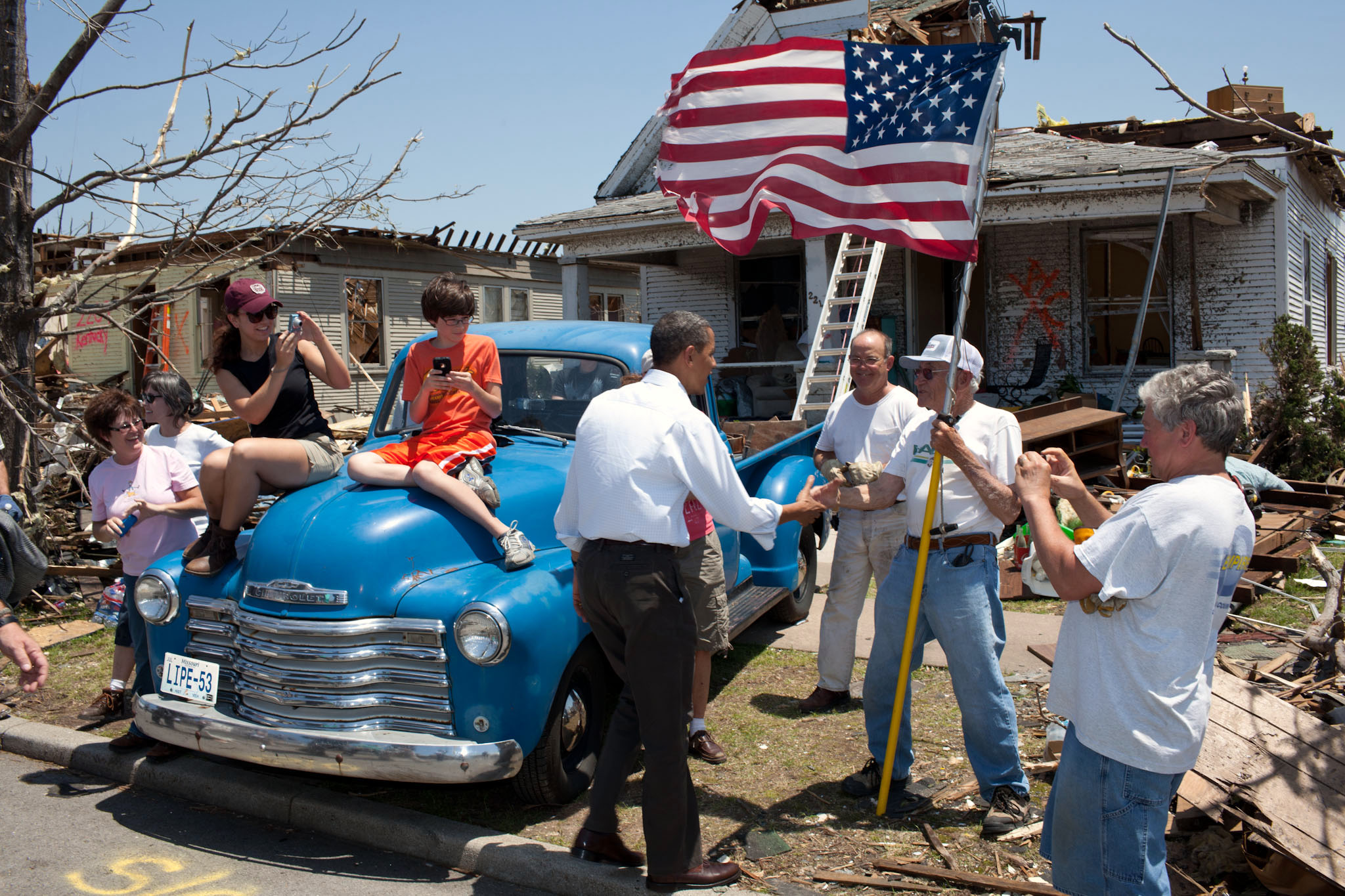 President Barack Obama Greets Hugh Hills In Front Of His Home In Joplin
