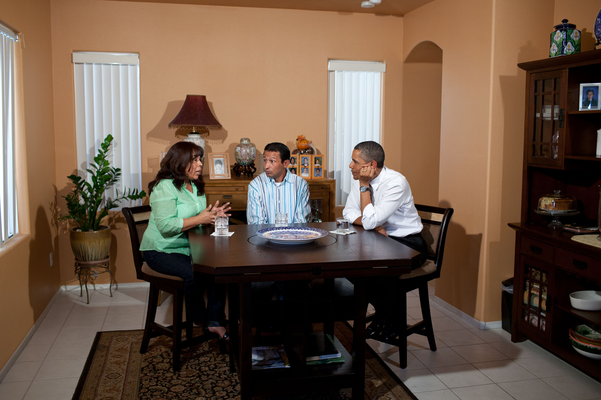 President Obama participates in a kitchen table discussion regarding the American Jobs Act
