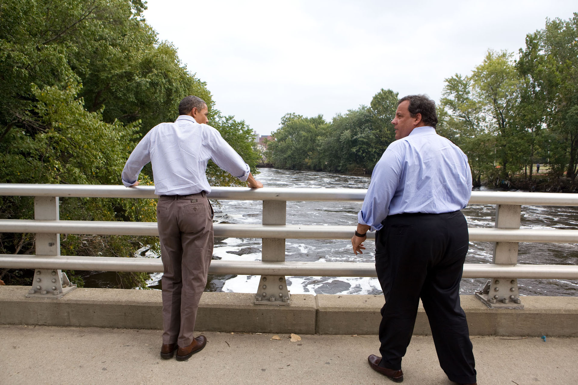 President Barack Obama and New Jersey Gov. Chris Christie look at the swollen Passaic River from the Main Street Bridge in Paterson