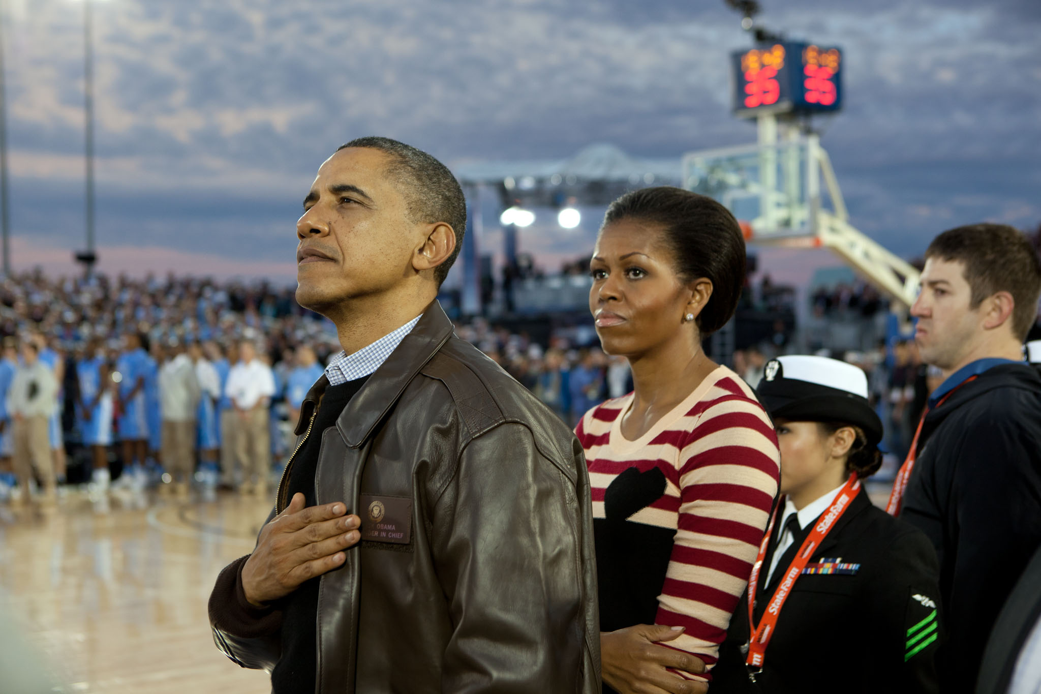 President Obama And The First Lady Watch The Retiring Of The Colors