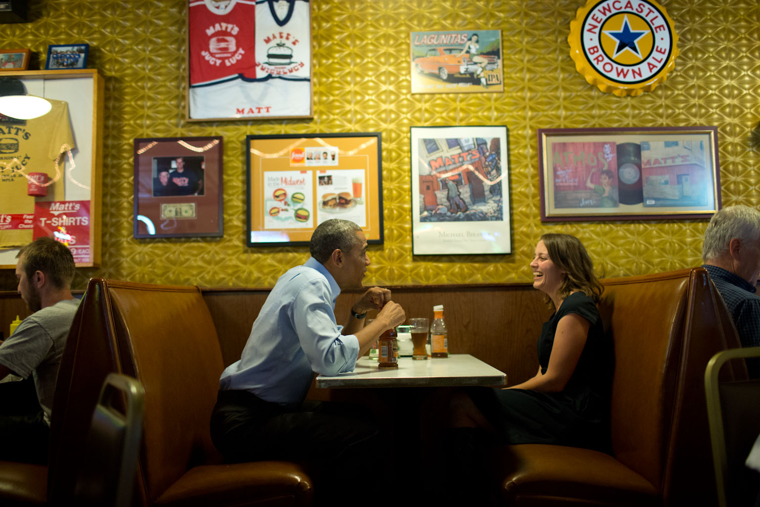 President Barack Obama has lunch with Rebekah Erler at Matt's Bar in Minneapolis, Minn., June 26, 2014. Erler is a 36-year-old working wife and mother of two pre-school aged boys who had written the President a letter about economic difficulties.