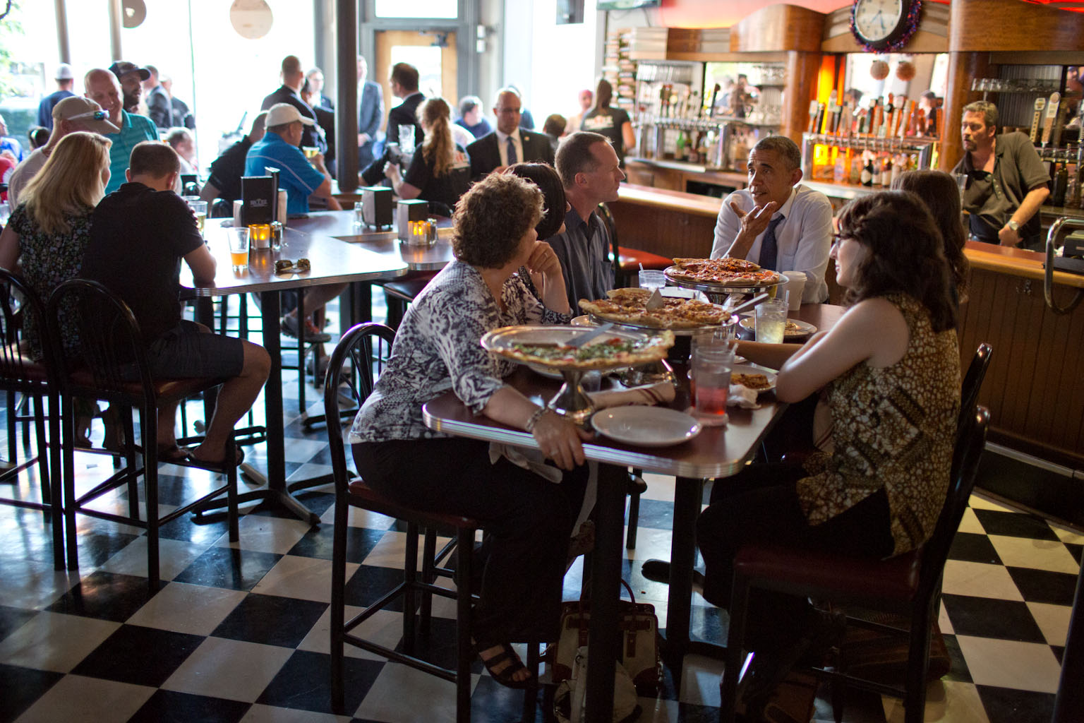 President Barack Obama has a pizza dinner with local residents who had written him letters, in Denver, Colorado, July 8, 2014.