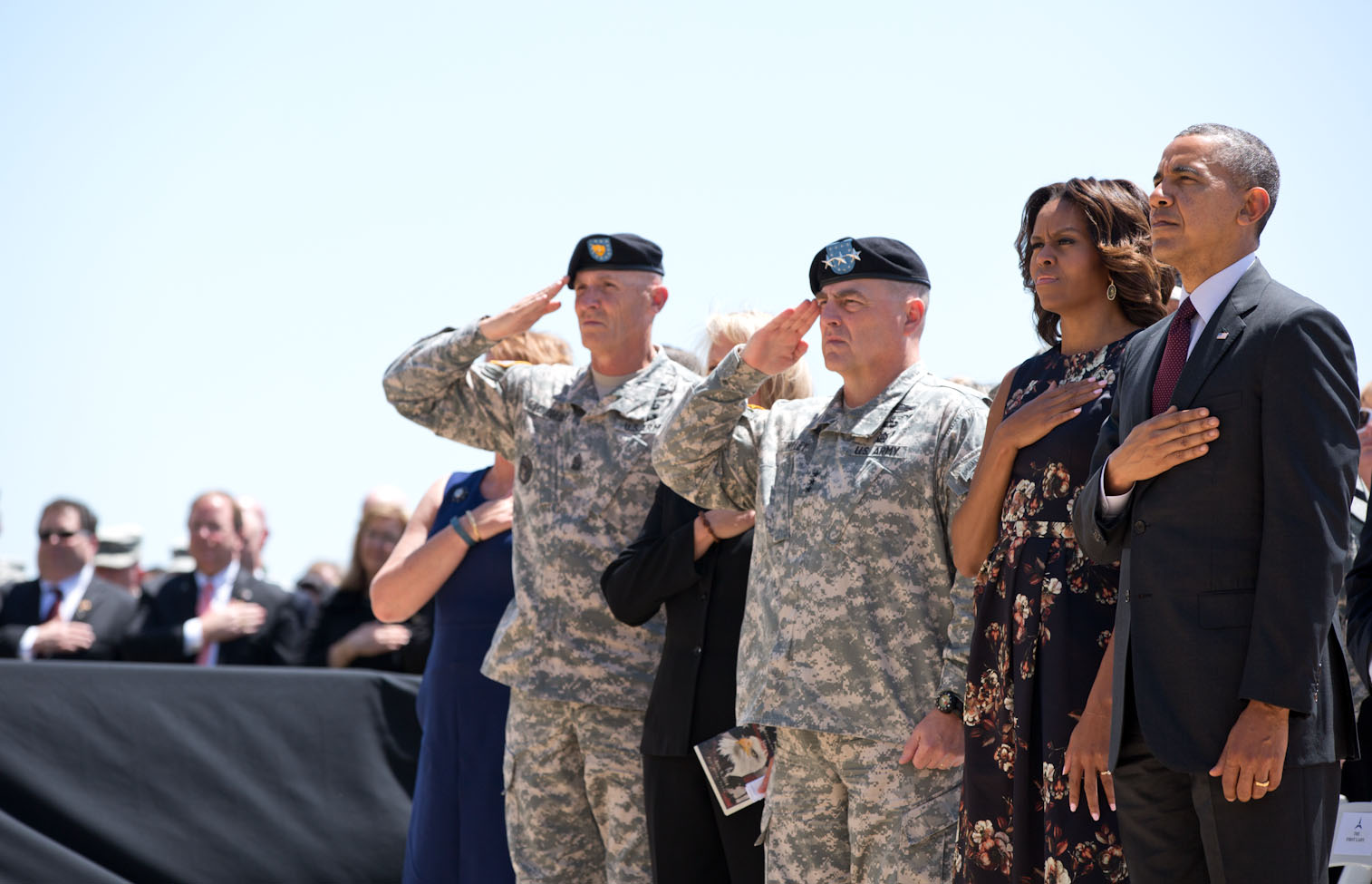 President Barack Obama and First Lady Michelle Obama join other officials during a memorial service for the victims of the Fort Hood shootings, at Fort Hood in Killeen, Texas