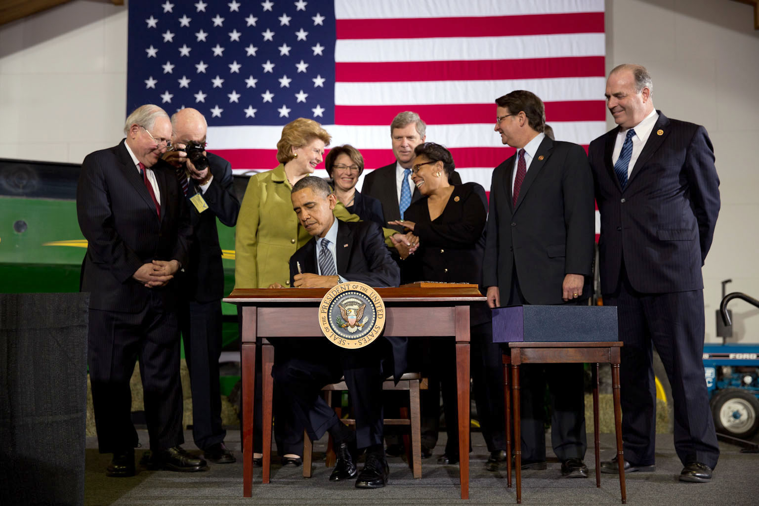 President Barack Obama signs the Farm Bill at Michigan State University in East Lansing, Michigan