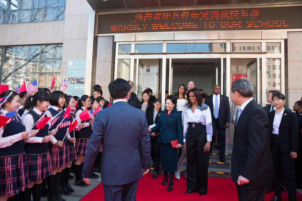First Lady Michelle Obama and Madam Peng are greeted by a group of students as they leave the Beijing Normal School in Beijing, China