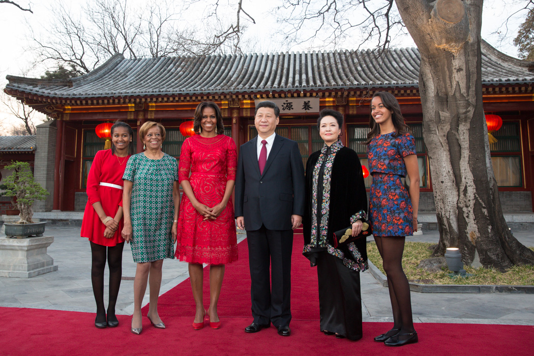 First Lady Michelle Obama, along with daughters Sasha, Malia and her mother Marian Robinson, visit with President Xi Jinping of the People's Republic of China and Madam Peng in the courtyard of the Diaoyutai State Guesthouse in Beijing, China