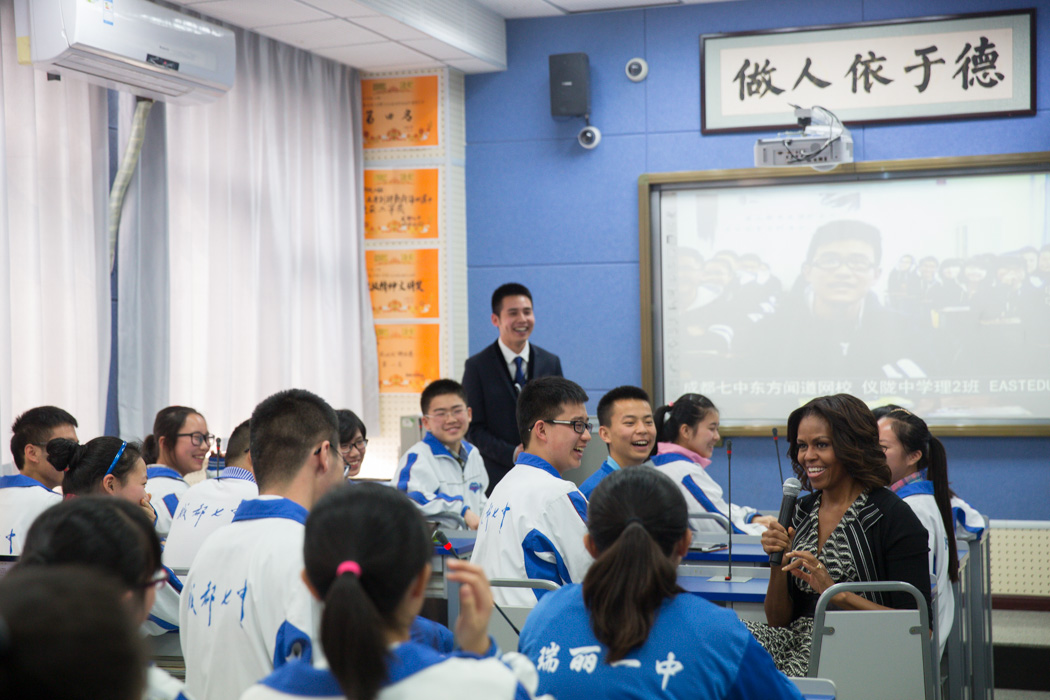 First Lady Michelle Obama talks with students in an interactive classroom at Number 7 School in Chengdu
