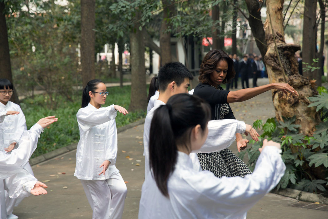 First Lady Michelle Obama participates in Tai Chi with students from Number 7 School in Chengdu