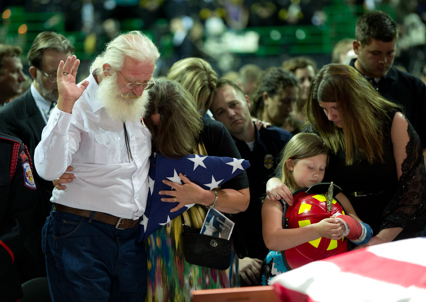 Family members react during a memorial service at Baylor University