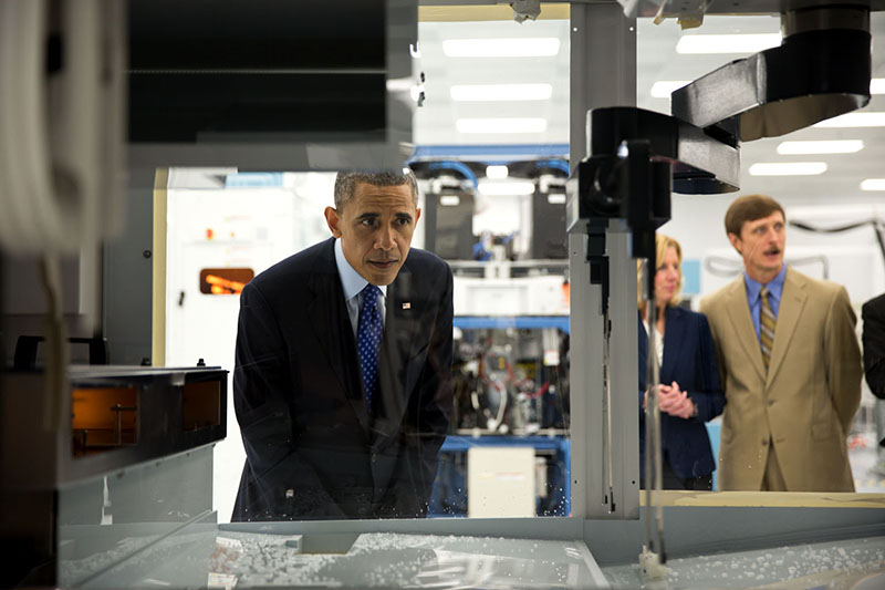 President Barack Obama views equipment during a tour of Applied Materials