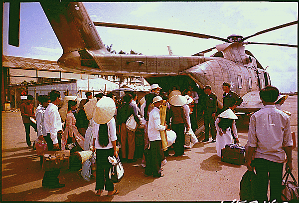 South Vietnamese villagers board a CH-3C helicopter, 1966