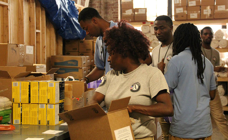 AmeriCorps members assemble energy kits in Baltimore