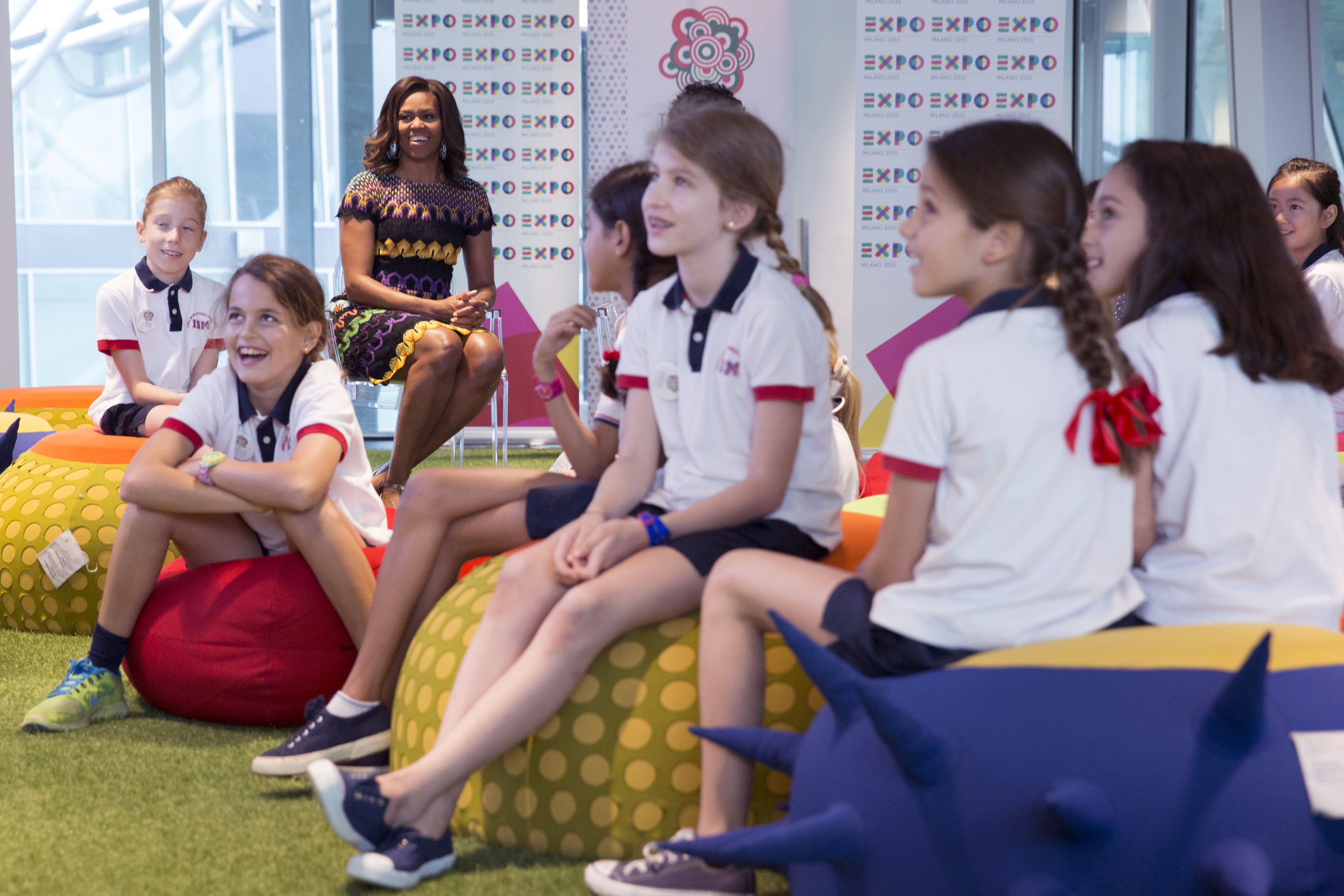 First Lady Michelle Obama watches food conservation videos at the World Expo in Milan