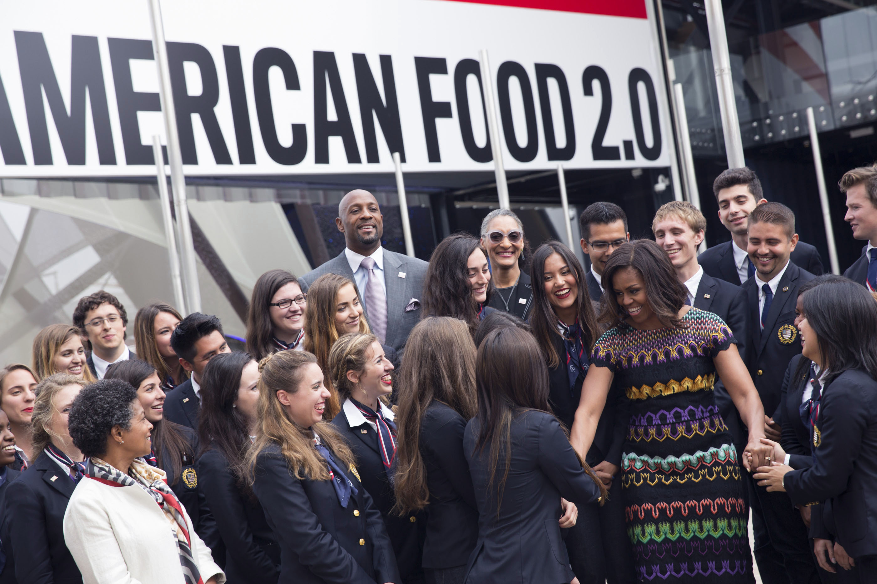 First Lady Michelle Obama is greeted by student ambassadors at Milan World Expo