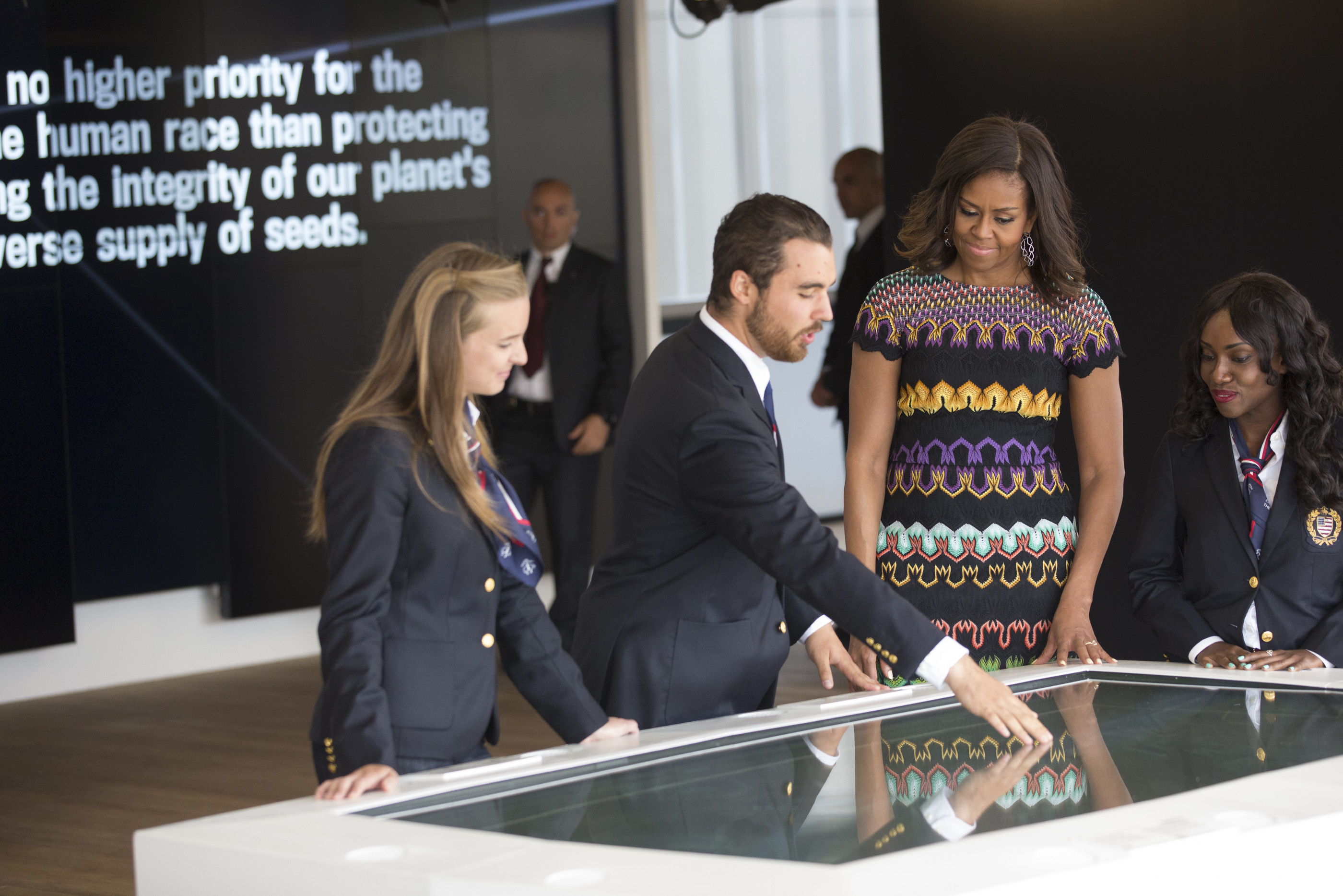 First Lady Michelle Obama watches a interactive game demo
