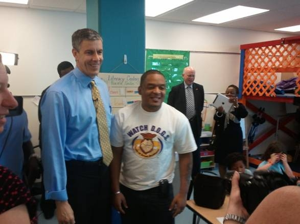 Secretary Arne Duncan visits with a Watch D.O.G.S. dad