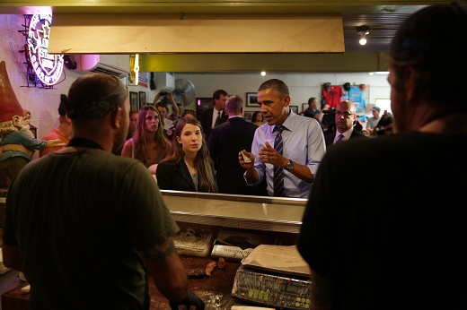 President Barack Obama orders lunch during a local stop at Franklin Barbecue