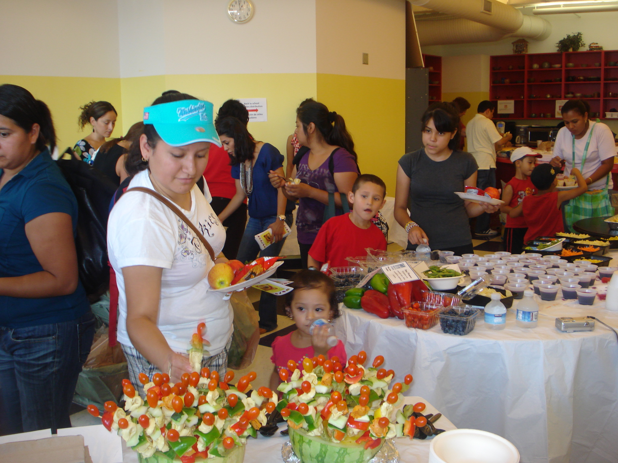 Families sample healthy fare at the Mary's Center Back to School Drive