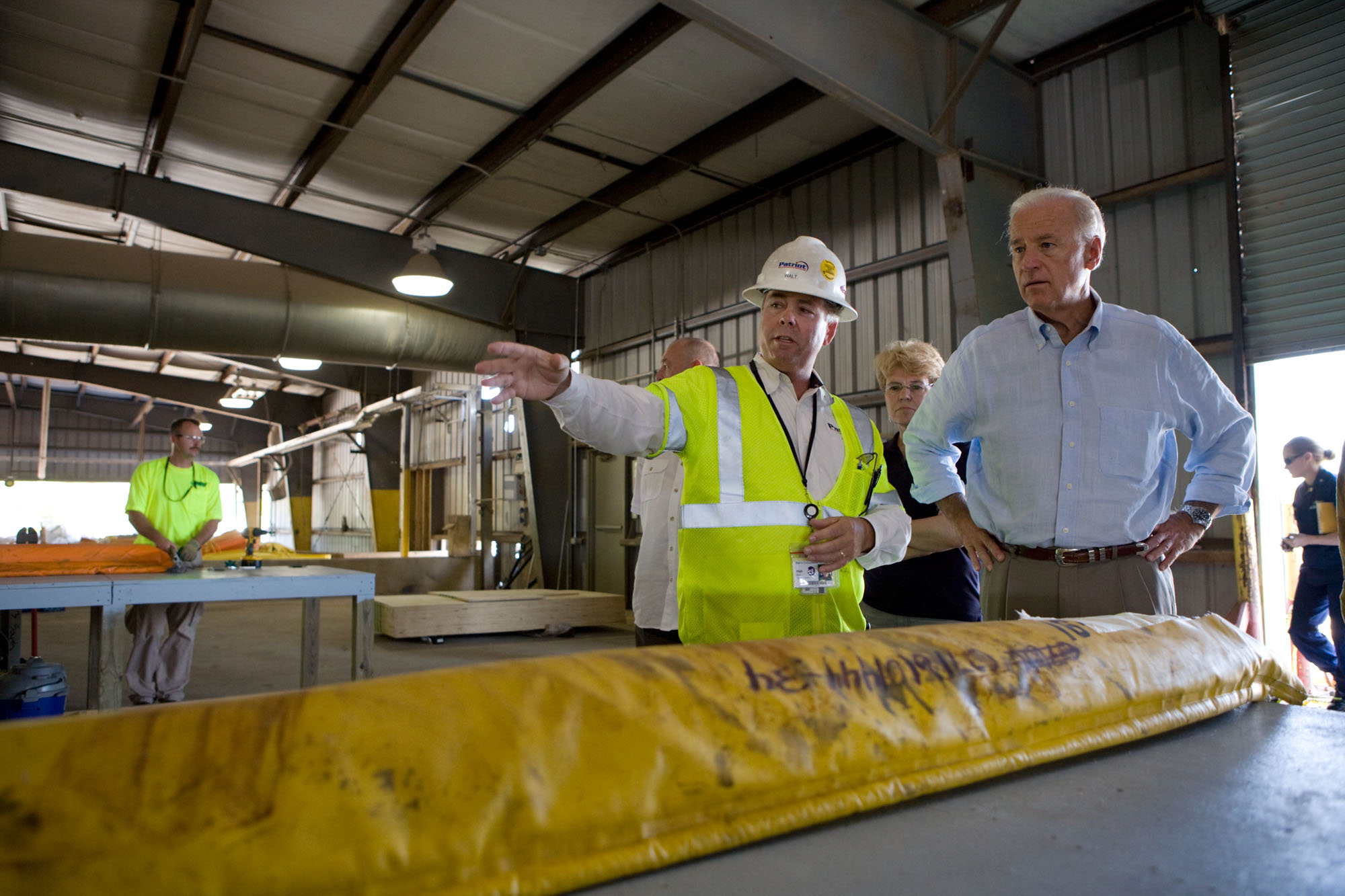 Vice President Joe Biden is led on a tour of the boom repair area