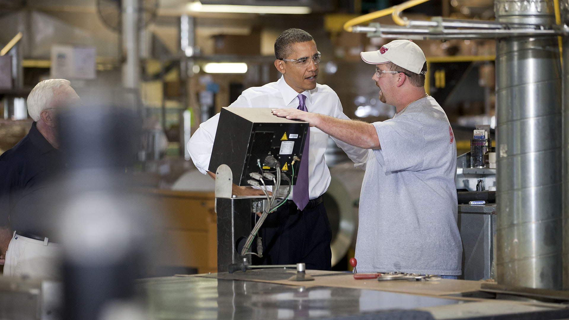 President Barack Obama Talks with Workers While Touring Stromberg Metal Works