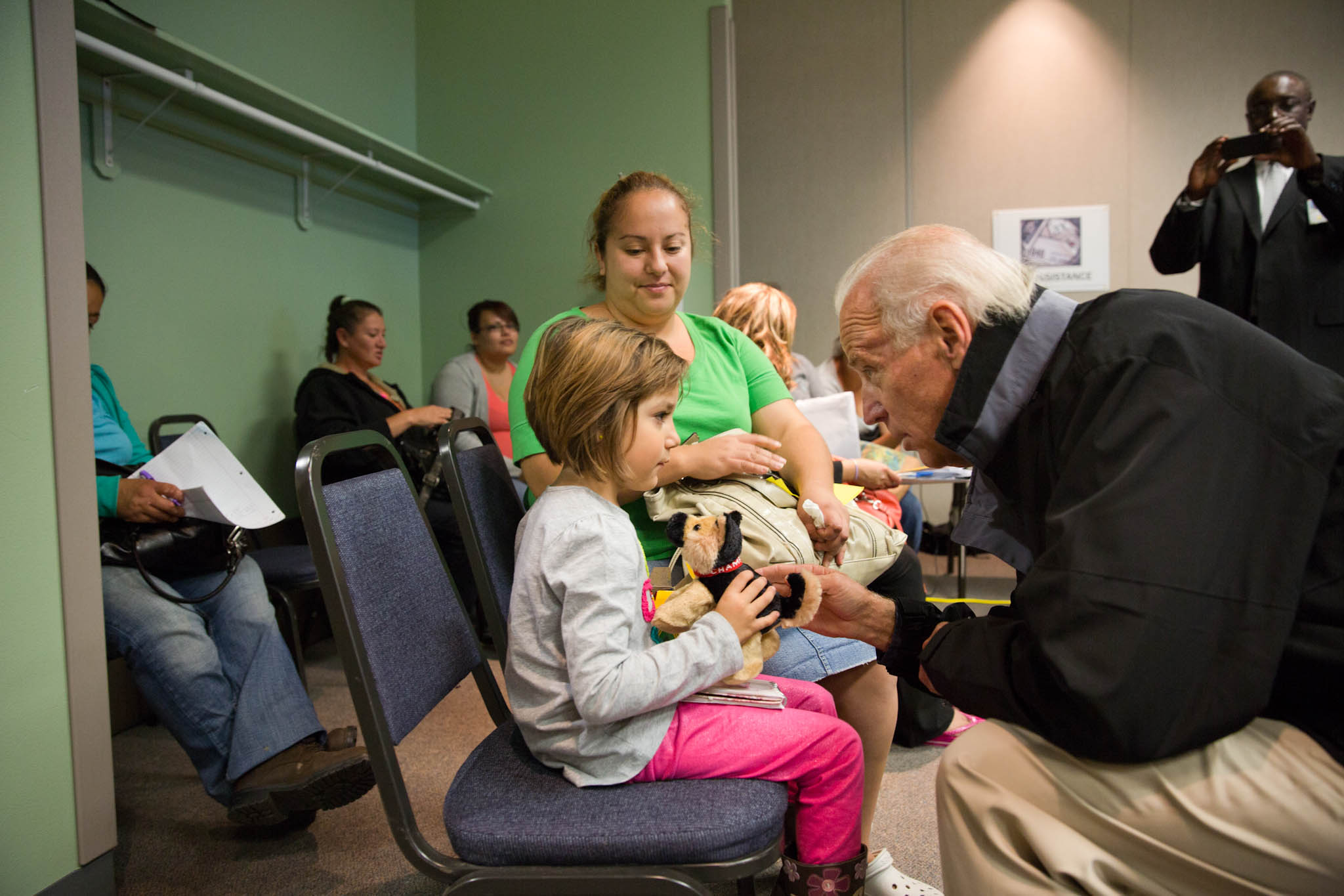 Vice President Joe Biden give Champ the stuffed animal to Alahy Cerrillo, 5