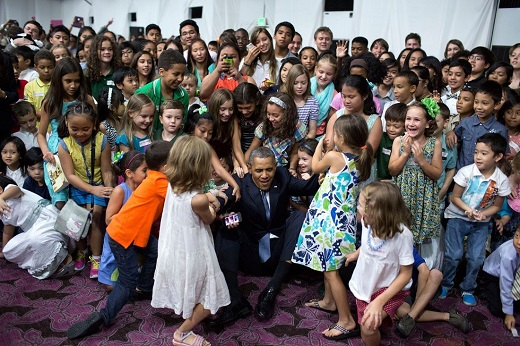 Children help President Barack Obama to his feet