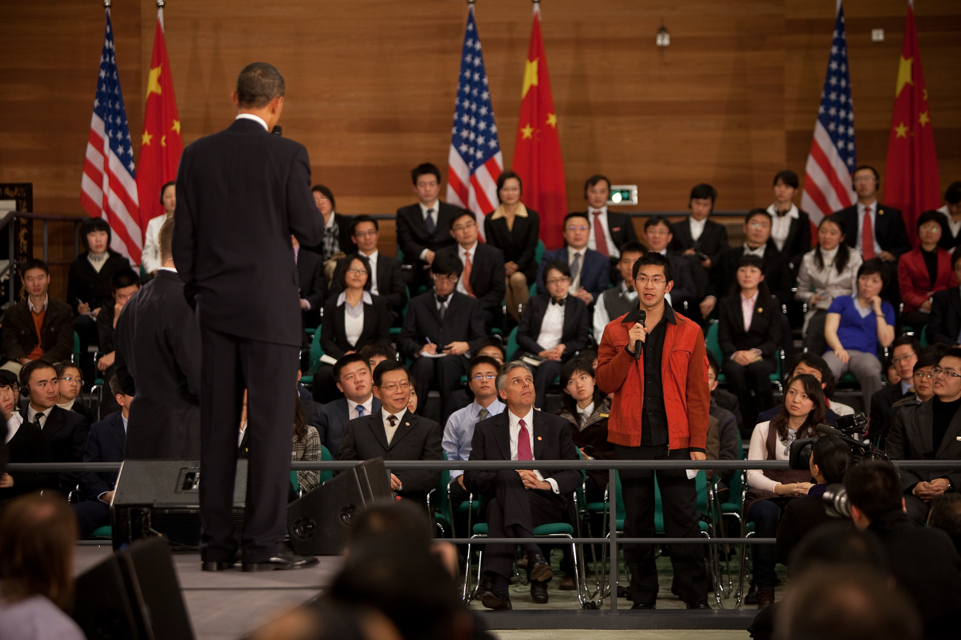 President Barack Obama listens to a question at the town hall meeting with future Chinese leaders