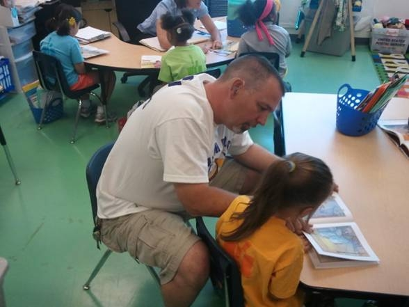 Watch D.OG.S. Dad Volunteers with Reading
