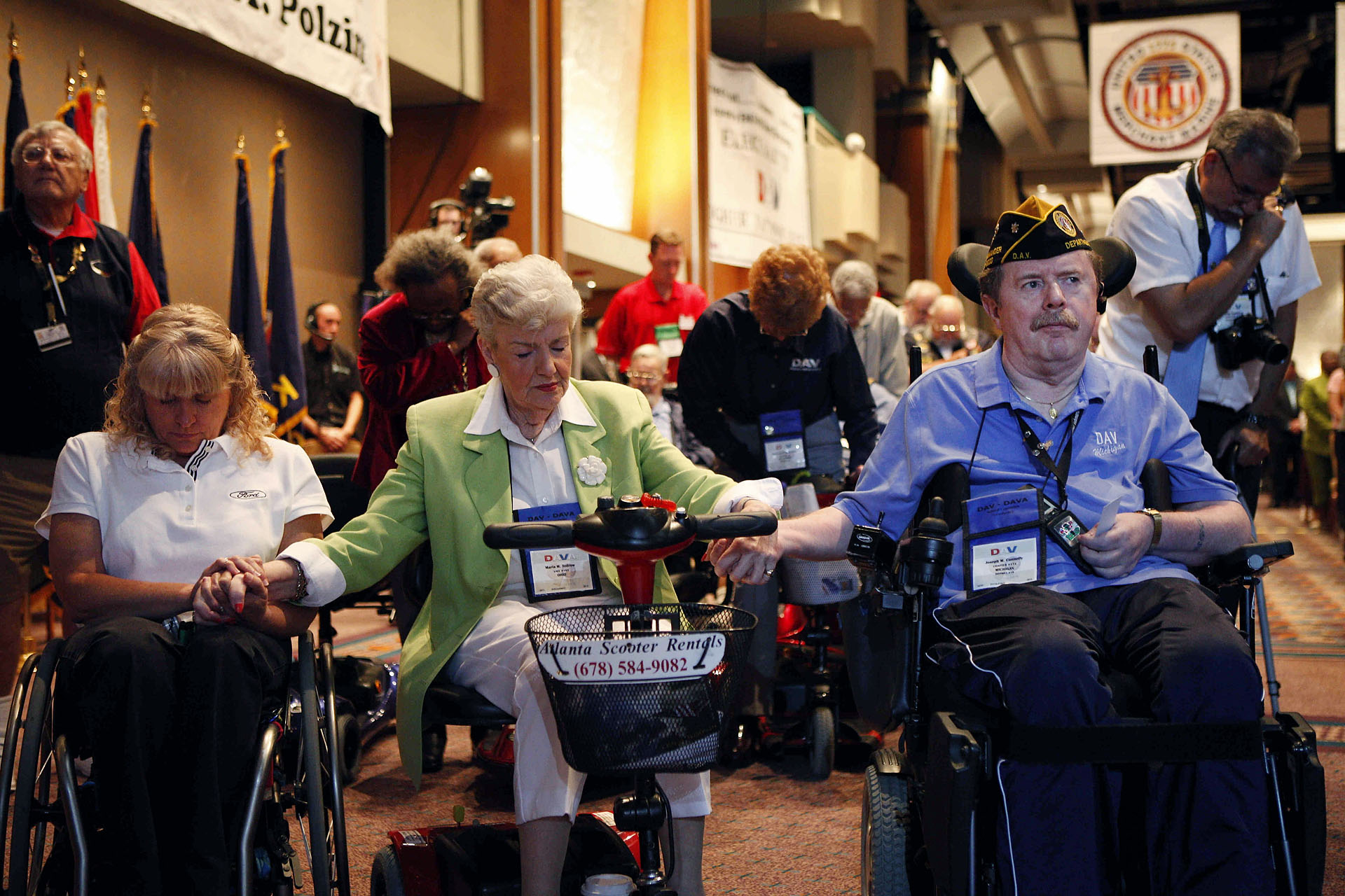 Delegates Hold Hands During a Prayer at the Disabled American Veterans 89th National Convention