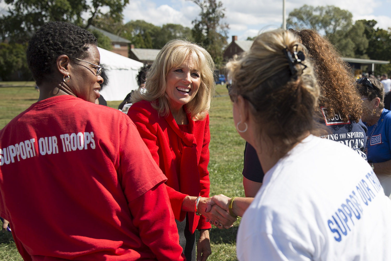 Dr. Jill Biden greets members of the USO after a homecoming ceremony
