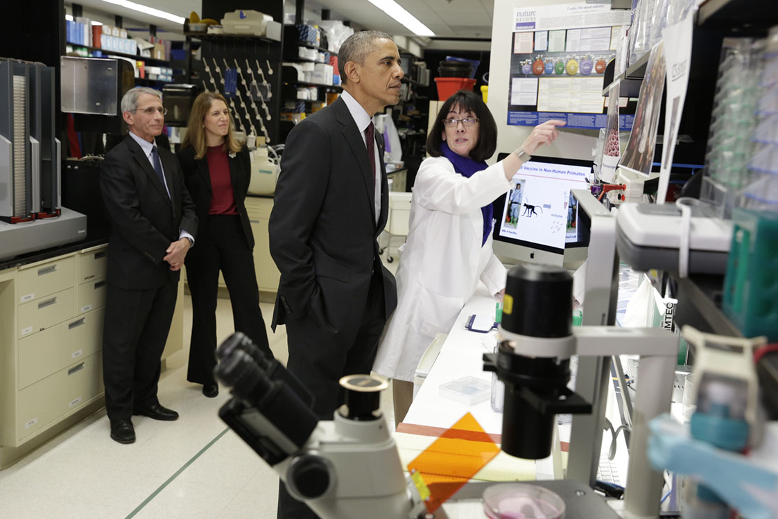 President Obama tours a lab at the Vaccine Research Center at the National Institutes of Health