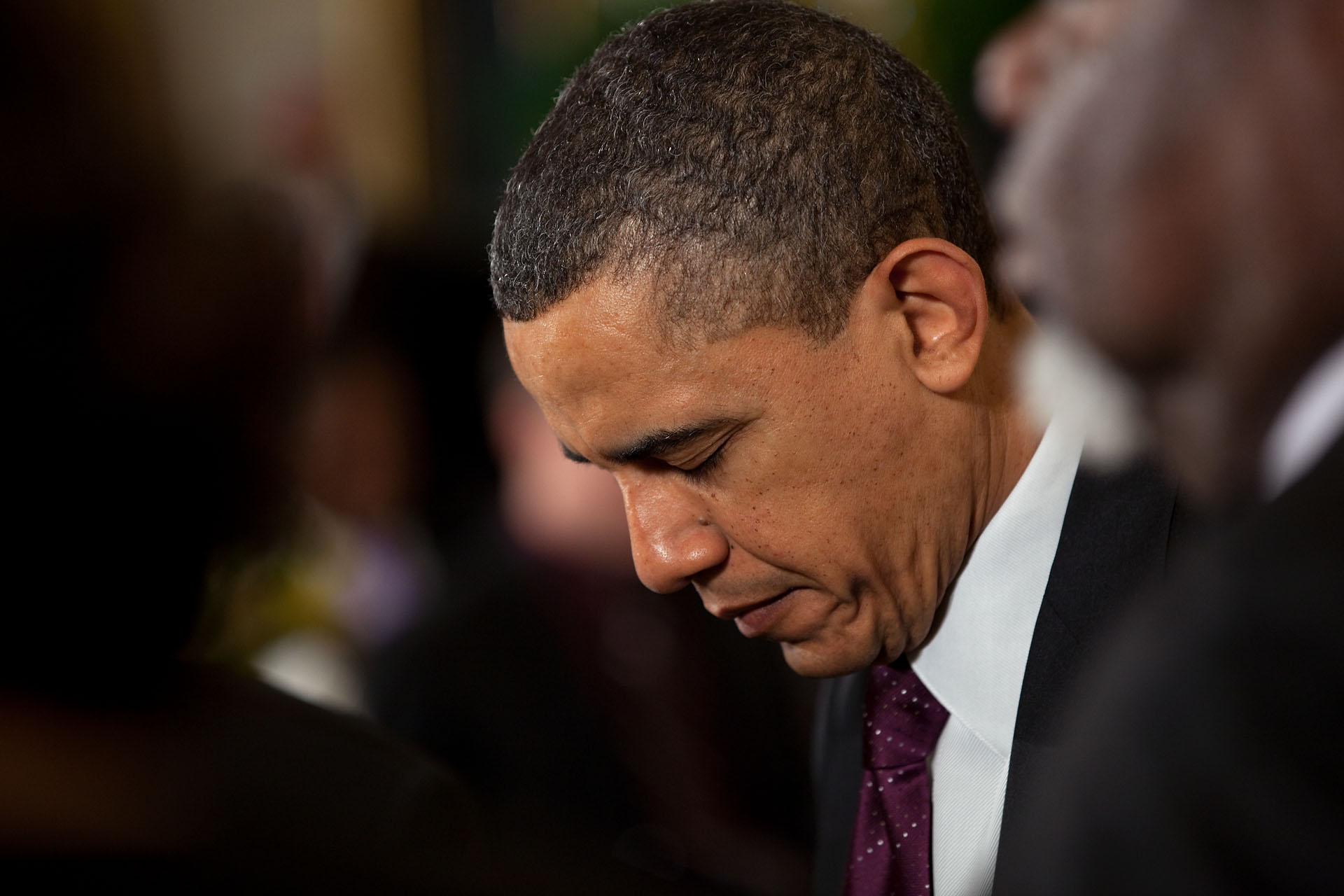 President Barack Obama Bows His Head During the Easter Prayer Breakfast in the East Room of the White House