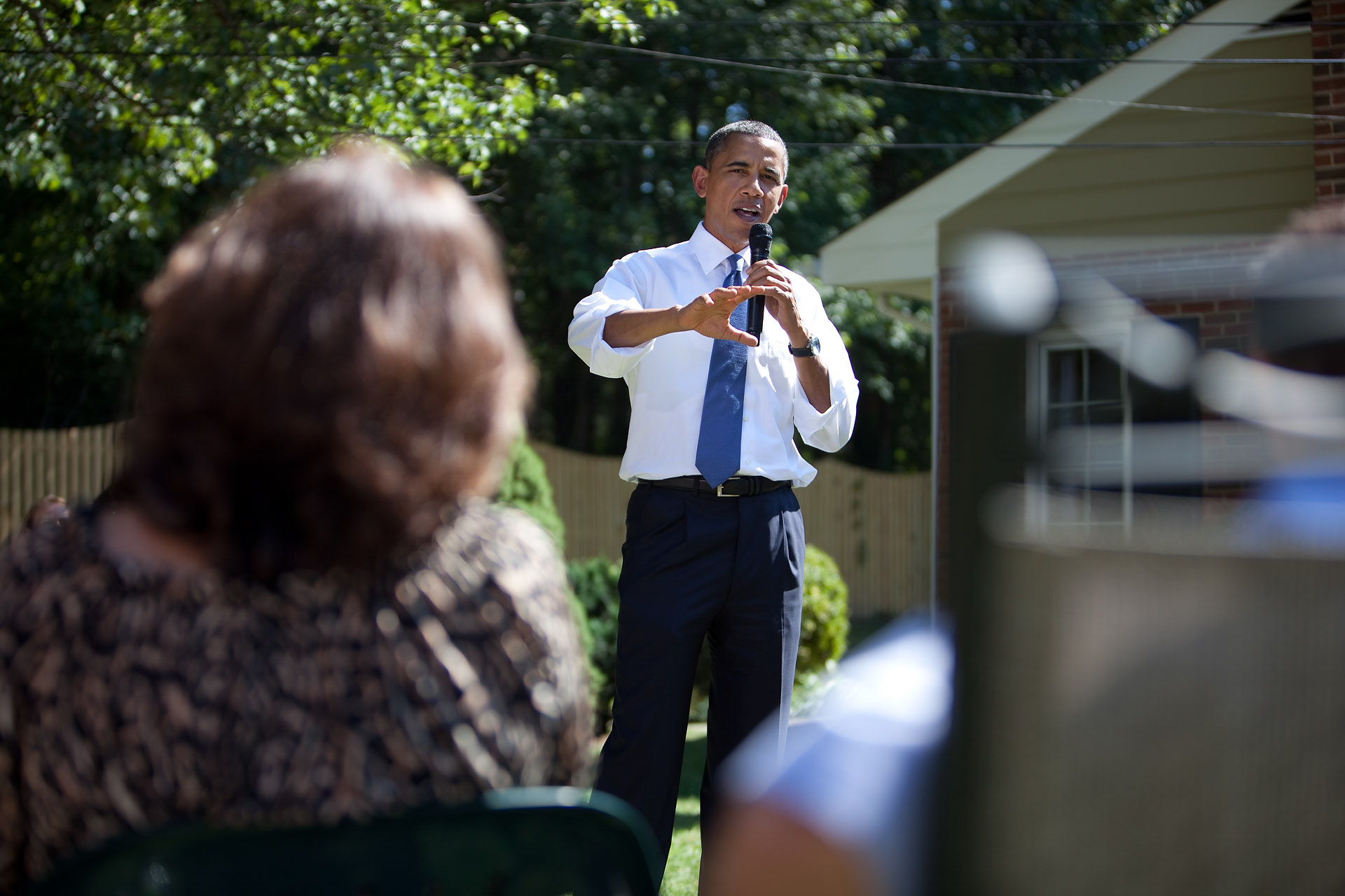President Barack Obama Responds to a Question During a Discussion on the Economy with Area Families in the Backyard of the John Nicholas and Nicole Armstrong Family Home in Fairfax, Virginia