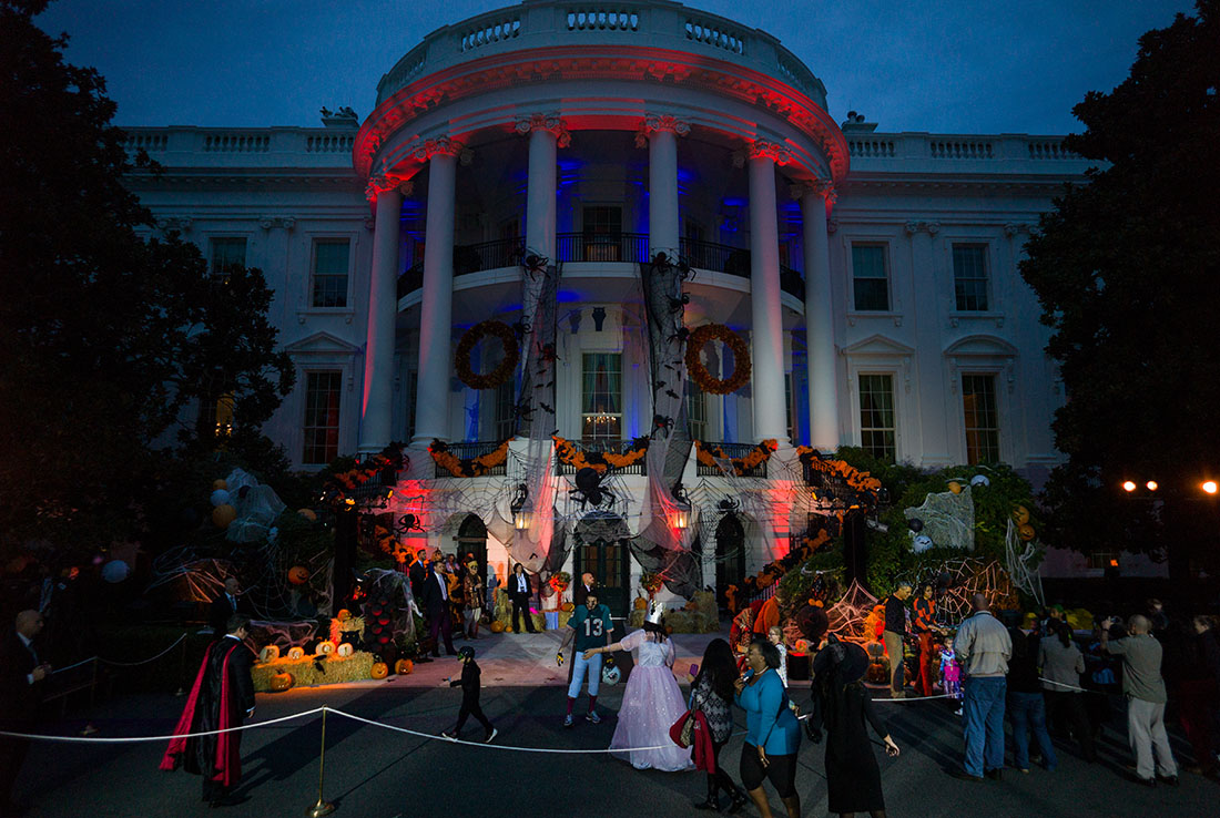 President Barack Obama, First Lady Michelle Obama and Mrs. Marian Robinson hand out Halloween treats to local children