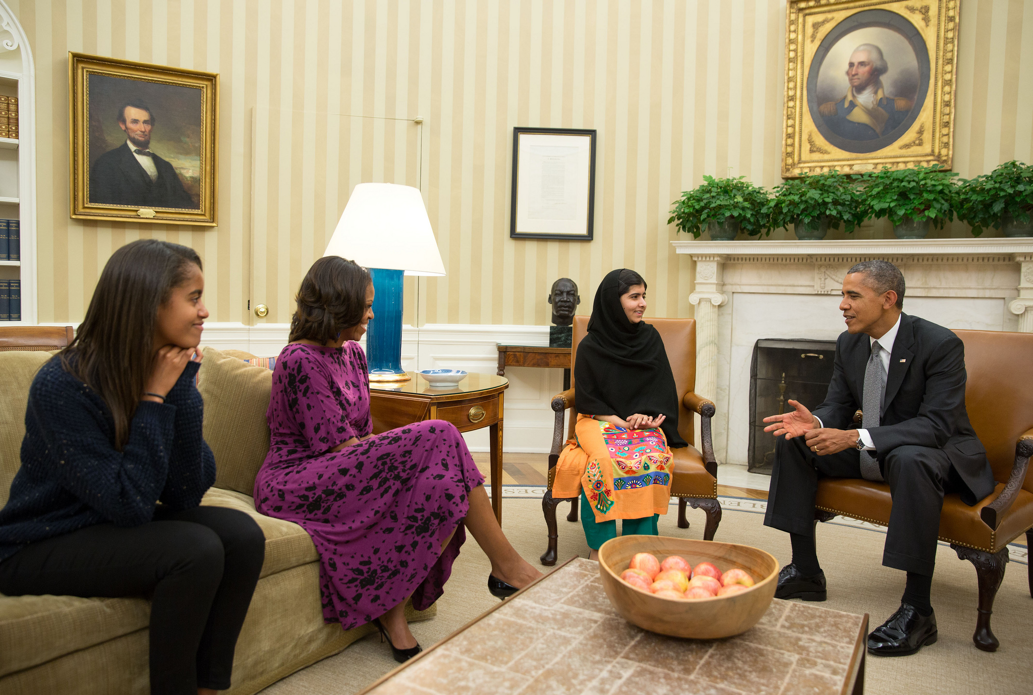 President Barack Obama, First Lady Michelle Obama, and their daughter Malia meet with Malala Yousafzai