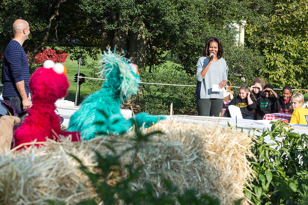 First Lady Michelle Obama, with Sesame Street's Elmo and Rosita, join students for the annual fall harvest of the White House Kitchen Garden