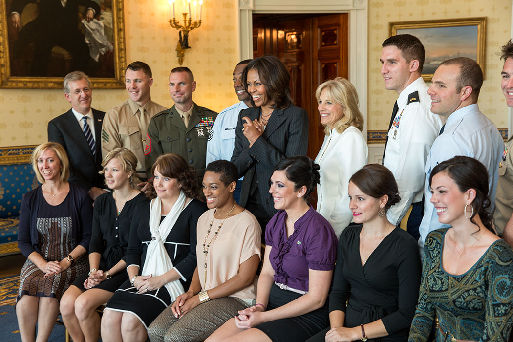 First Lady Michelle Obama and Dr. Jill Biden join USO honorees for a group photo