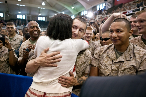 FLOTUS hugging a member of the military