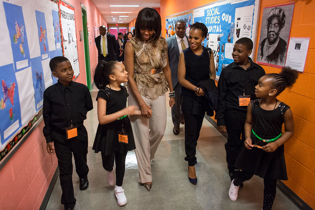 First lady Michelle Obama and Kerry Washington are escorted between classes by students