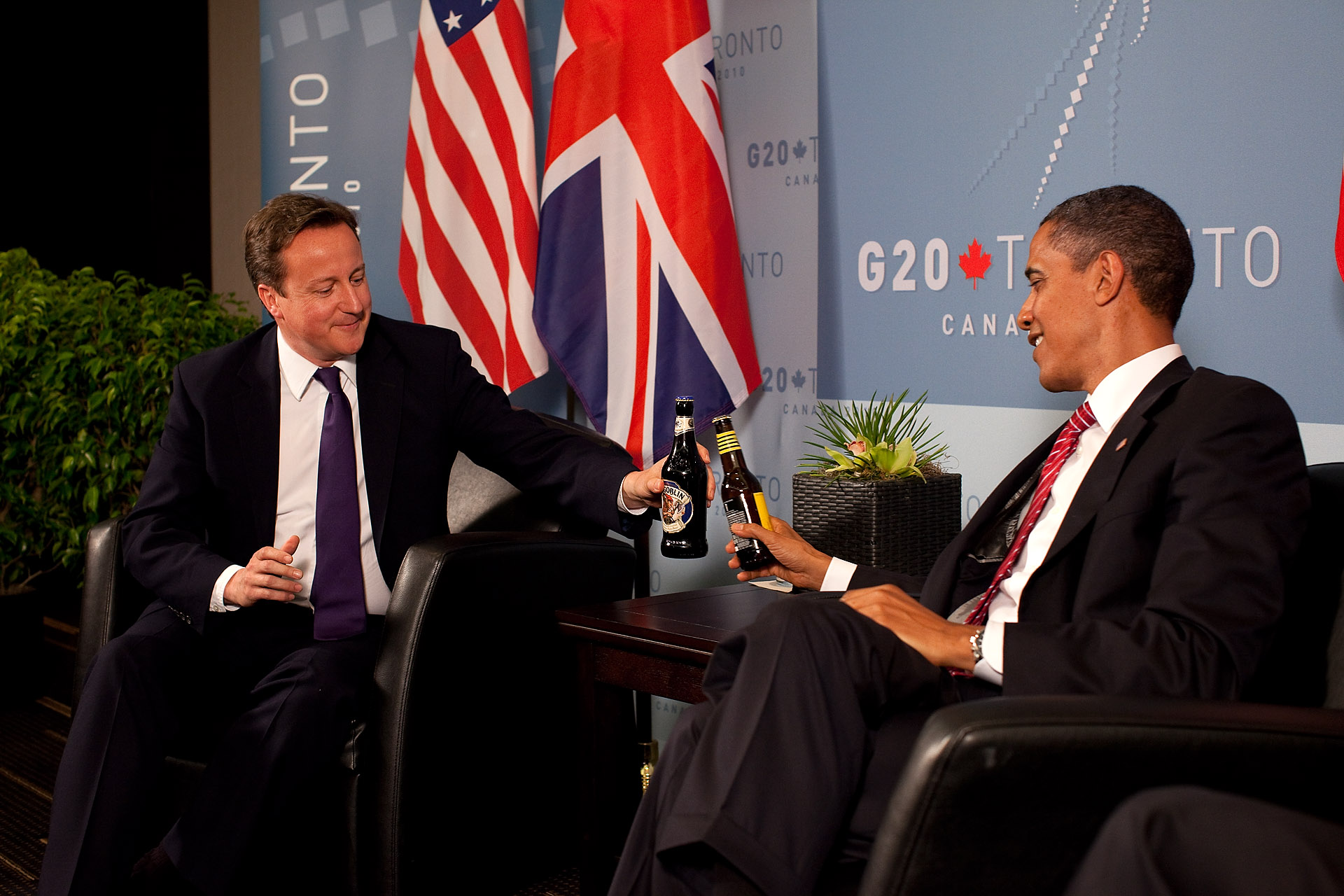 President Barack Obama and British Prime Minister David Cameron Trade Bottles of Beer to Settle a Bet on the US-UK World Cup Soccer