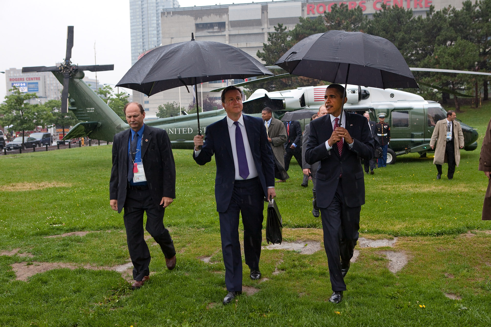 President Barack Obama and British Prime Minister David Cameron Walk in Rain from G8 Summit
